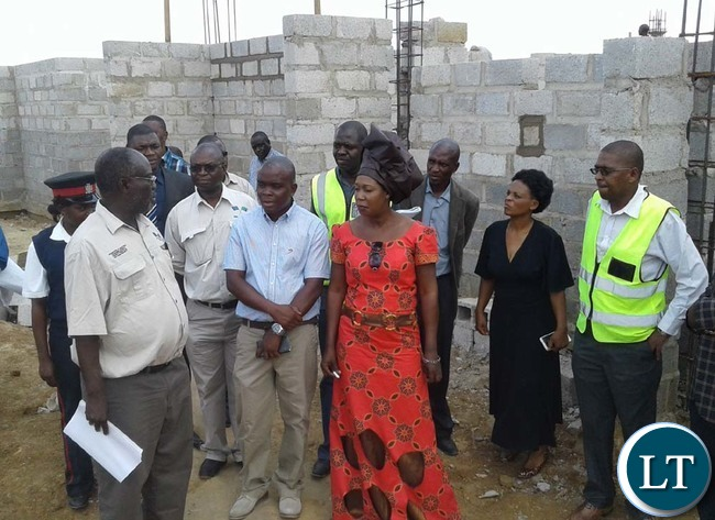 WORKS and Supply deputy Minister Mutaba Mwali (left) talks to Lamsa Enterprise Limited director Alexander Mumbi and Chikankanta District Commissioner Kavumbu Hakachima (far right) at the site for construction of a police station in Chikankanta. Picture y CHILA NAMAIKO