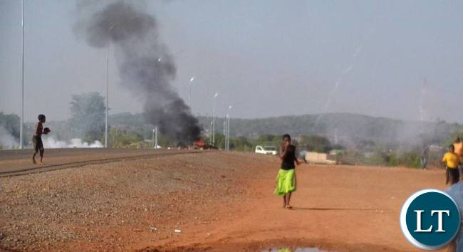 Some tenants riots against their eviction on Contract Haulage houses in Chipata yesterday.The tenants burnt tyres and block the Great East road.Pictures By VINCENT SOKO
