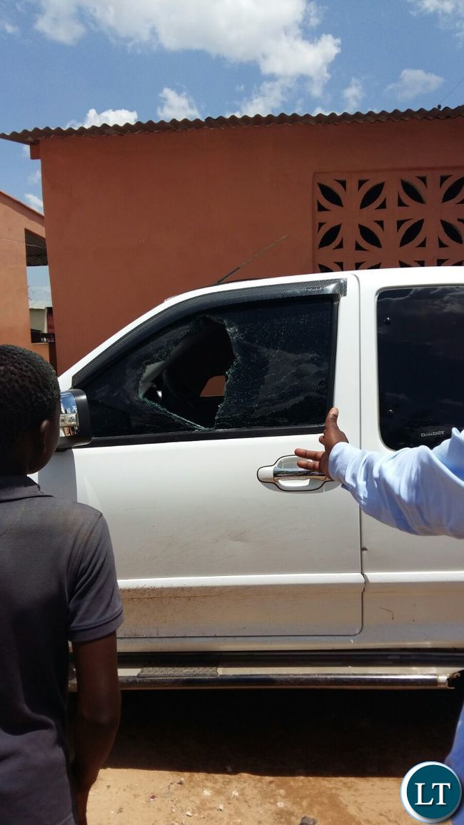 Smashed windows of one of the vehicles belonging to the  FDD