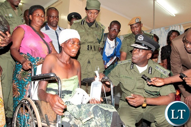 Inspector General of Police Kakoma Kanganja consoles Ireen Kaluba at University Teaching Hospital who was hit by a Police car in Kafue