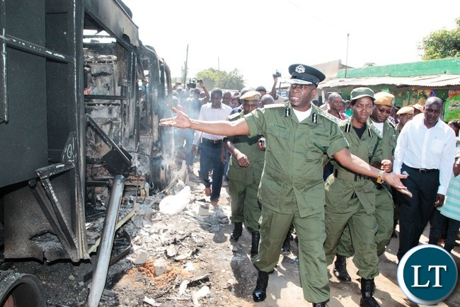 Inspector General of Police Kakoma Kanganja looks with pain at the fire tender that was burnt at Lumumba Police Post in Chawama Compound Kafue