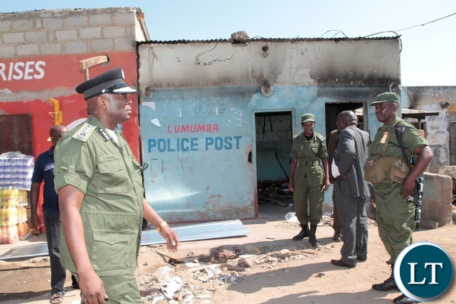 Inspector General of Police Kakoma Kanganja inspects Lumumba Police Post in Chawama Compound Kafue that was burnt by people in the area