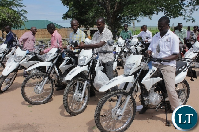 Mongu District Agriculture officers after receiving their motorbikes during the donation of 14 motorbikes and 300 bicycles to Government Ministries involved in Scaling Up Nutrition activities to fight against malnutrition in children in Mongu
