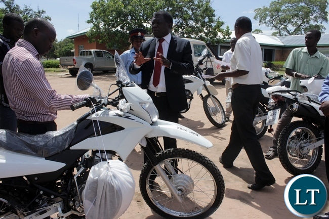 Mongu District Commissioner Susiku Kamona (c) urging officers to use motorbikes for the intended purpose during the donation of 14 motorbikes and 300 bicycles to Government Ministries involved in Scaling Up Nutrition activities to fight against malnutrition in children in Mongu