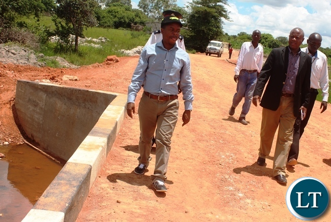 Bwacha MP Sydney Mushanga (left) with Central Province DPS checking on the newly constructed Bridge in Kabwe's Kalwelwe area in the out-skirts of Kabwe.