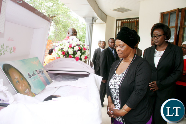 First Lady Esther Lungu pays her last respects to Luapula Province minister  Brig Gen Benson Kapaya's daughter Mumba during the funeral service at St Andrews  UCZ Church in Lusaka on  Wednesday, January 13,2016 -Picture by THOMAS NSAMA