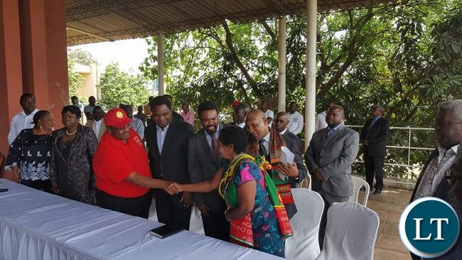 GBM shakes hands with Rose Banda