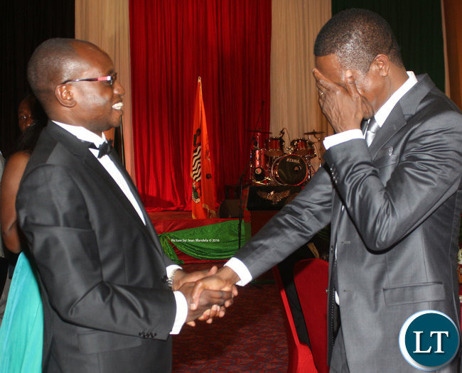 President Edgar Chagwa Lungu and his special assistant to the press Amos Chanda share a light moment