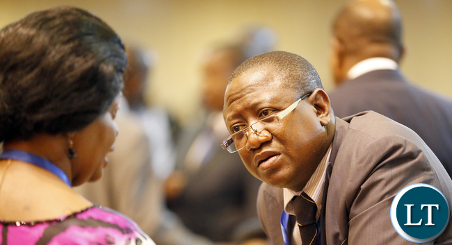 Mr Sam Mujuda talks to Ambassador Susan Sikaneta during the NEPAD heads of State and Government Summit in Addis