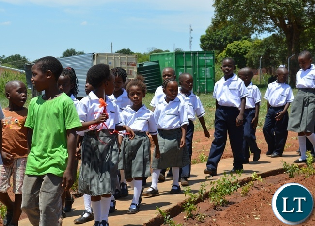 Victoria Falls Adventist Primary School pupils leading in during the official opening of Victoria Falls Adventist Primary School in Livingstone o