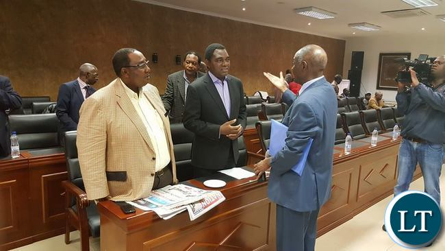 VETERAN Politician Vermon Mwanga stresses a point to UPND leader Hakainde Hichilema and his Vice President, Godfrey Bwalya at the Courtyard Hotel in Lusaka where opposition Political Parties among them Rainbow Party,UPND, ADD, Peoples Party, Green Party, UPP and NDP are scheduled to hold a joint press conference.