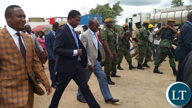 President Lungu with his Assistant for press Amos Chanda