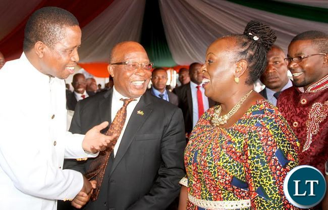 President Lungu talks to MMD president Nevers Mumba and wife Florence Mumba as Cozmo Mumba looks on during assenting to the Constitutional Amendment Bill ceremony at Heroes Stadium on Tuesday, January 5,2016 -Pictures by THOMAS NSAMA