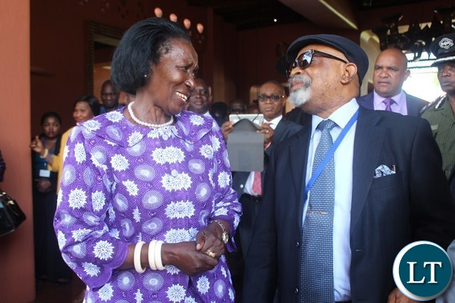 VICE President Inonge Wina talks to African Regional Labour Administration Centre (ARLAC) Vice Chairperson Dr. Chris Ngige. This was after official opening of ARLAC governing council meeting at Avani Victoria Falls Resort in Livingstone on Wednesday.