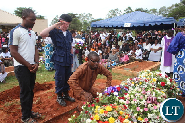 Cosmo Mumba and his Bodyguard laying awreaths
