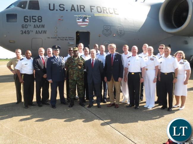 Ambassador Schultz and Zambian military officials greet U.S. military visitors.