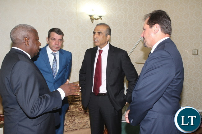 In the middle with a red tie Bharti Airtel CEO and Chairman Sunil Bharti Mittal with from left to right Airtel Networks Zambia Plc Board Chairman George Sokota , Airtel Africa MD & CEO Christian da Faria and Airtel Networks Zambia Plc Peter Correia.
