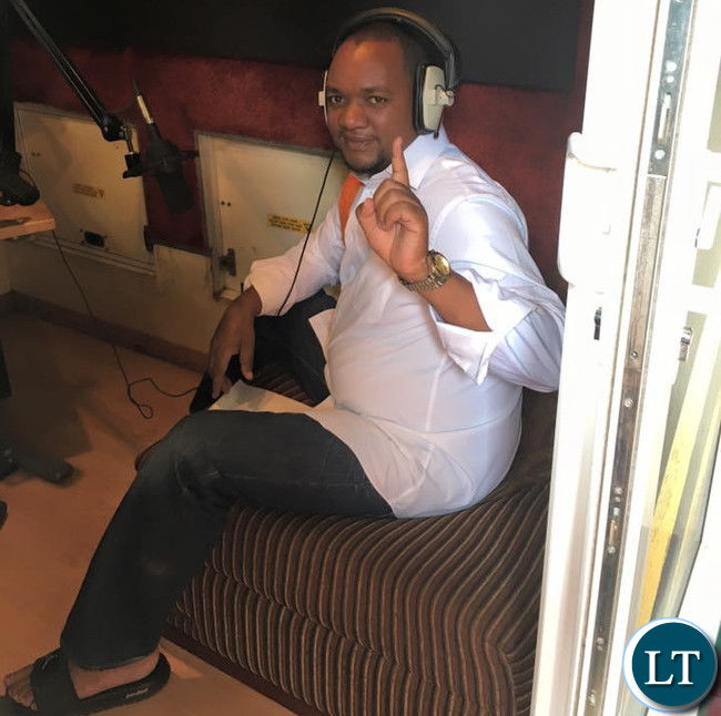Miles Sampa gestures the DF symbol during the radio programme on Hot FM