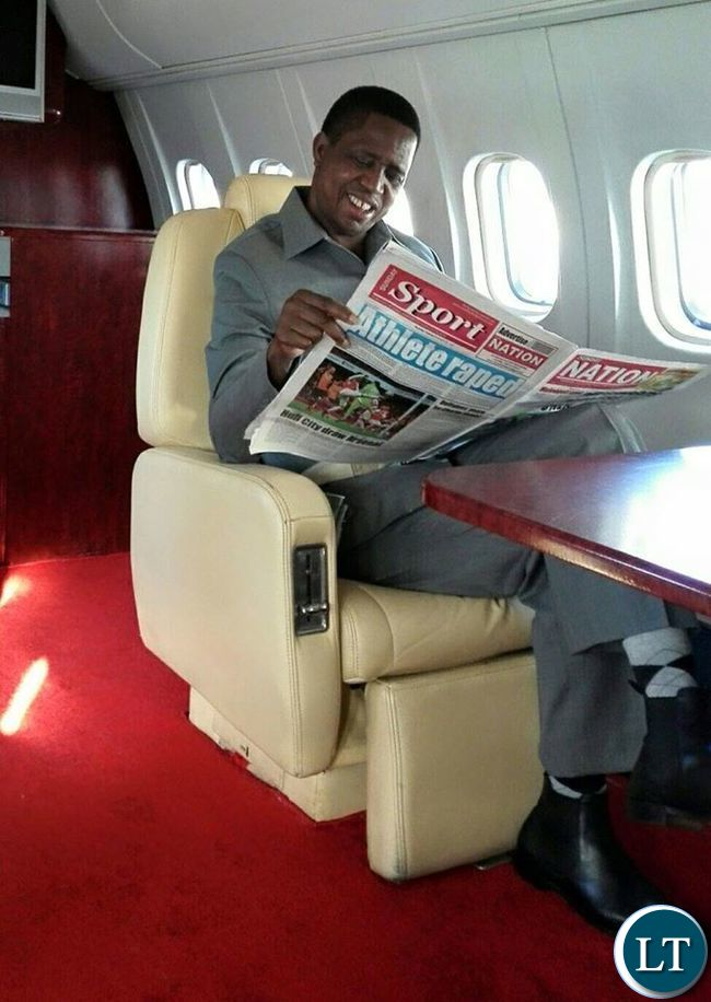 President Lungu reading the Posty Newspaper on the Plane enroute to Solwezi