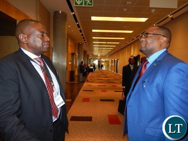 Zambia's High Commissioner to South Africa His Excellency Mr. Emmanuel Mwamba with ZESCO Board Chairperson Mr. Dillion Chipungu exchanging notes at the Africa Energy Conference in Johannesburg