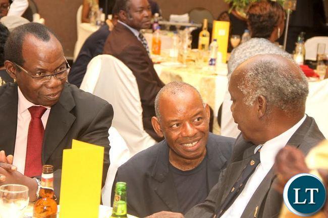Gen Peter Zuze (R) talks to Columnist Gabriel Banda (c) as FQM country manager Gen Kingsley Chinkuli looks on during the Wedding Ceremony of Masuzgo Kaunda Junior (grandson son of Dr Kenneth Kaunda) and Makomba Silwamba (daughter of Eric Silwamba) at InterContinental Hotel in Lusaka