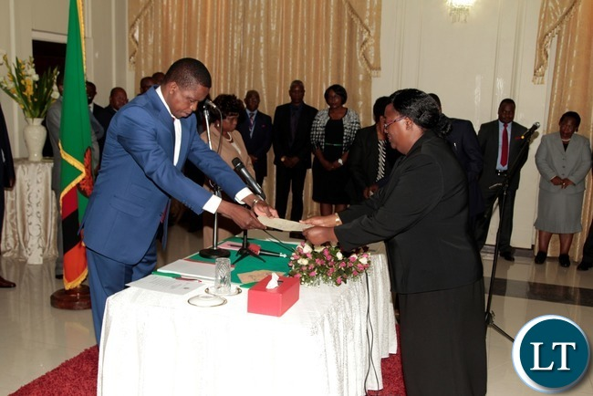 -President Edgar Lungu receive the orth from newly appointed Constitutional Court President justice Hildah Chibomba at State House