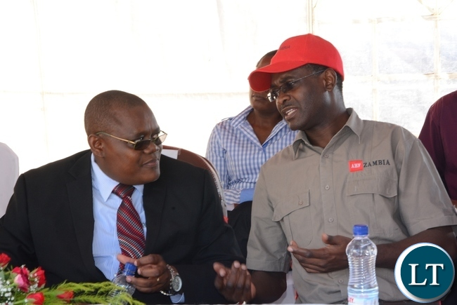 -Lusaka Province Medical Officer Kennedy Malama(r) having a light moment with Aids Health Care Foundation National Medical Director Brig-Gen Lawson Simapuka(l) immediately after handing over the Medical Equipments to Chifundo Clinic in Chaisa Compound