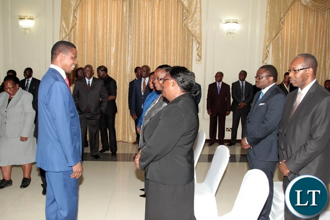 President Edgar Lungu chats with Constitutional Court Judges shortly after swearing in Ceremony of  Constitutional Court Judges at State House