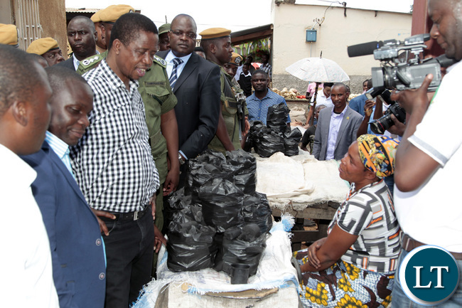President Lungu interacts with a charcoal marketers at Chisali main market