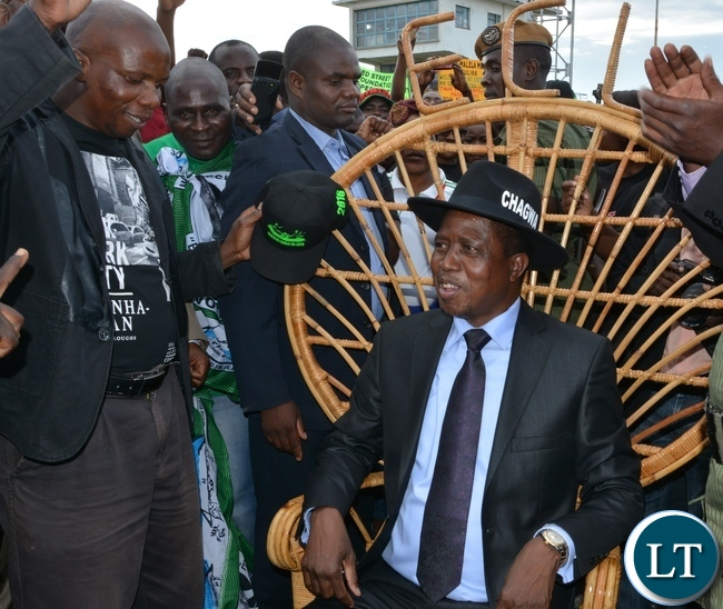 President Edgar Lungu having feel on the lid garden chair donated by Kangonga Center for blinds on his arrival at Simon Mwansa Kapwepwe airport