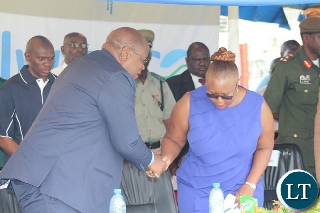 ENERGY and Water Development Minister Dora Siliya shakes hands with Southern Province Permanent Secretary Sibanze Simuchoba after giving her speech. This was during the National Water Day Commemoration at Choma Independence stadium