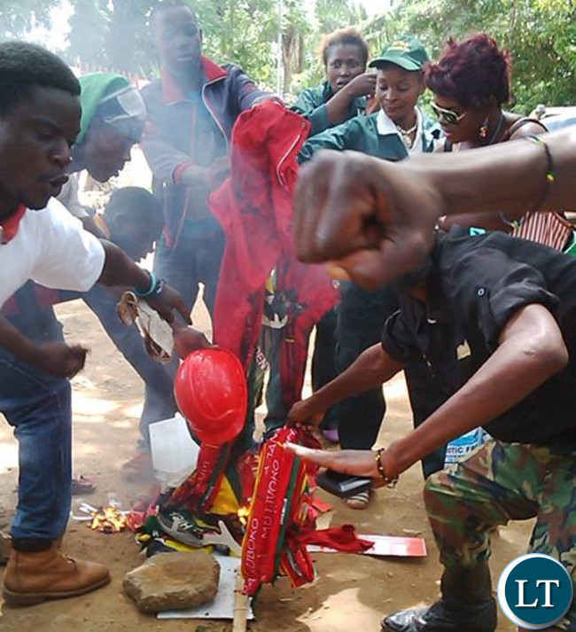 PF cadres burn UPND party regalia after the youths of the two political parties clashed against each other during the Youth Day Celebrations in Lusaka with one PF youth wearing the military outfit the party banned