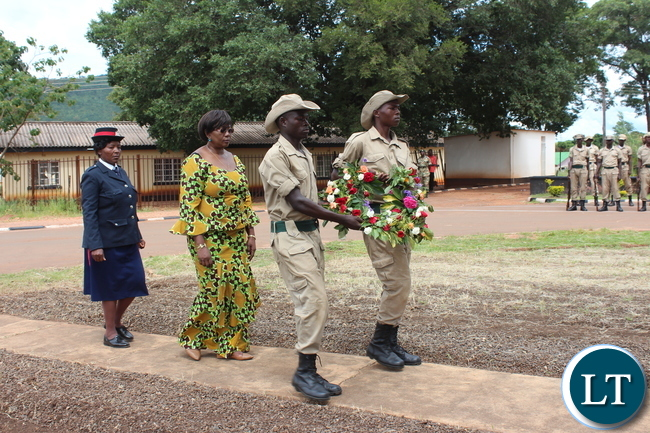 COMMUNITY Development and Social Welfare Minister, Emerine Kabanshi, walks to the cenotaph to lay a wreath during this year's commemoration of Youth Day in Chipata on Saturday. PICTURE BY STEPHEN MUKOBEKO/ZANIS
