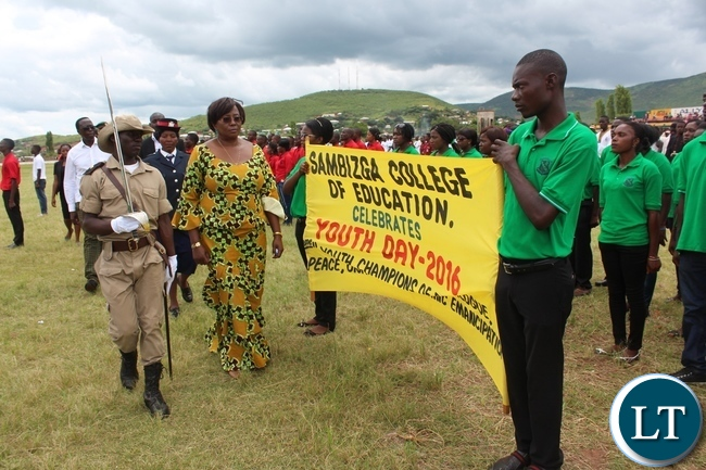 COMMUNITY Development and Social Welfare Minister, Emerine Kabanshi, inspects a guard of honour mounted by youth during the commemoration of Youth Day held at David Kaunda stadium in Chipata on Saturday. PICTURE BY STEPHEN MUKOBEKO/ZANIS