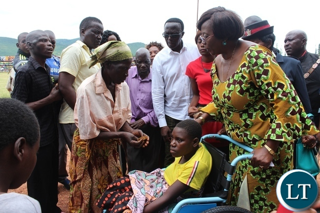 MINISTER of Community Development and Social Welfare, Emerine Kabanshi, presents a wheel chair to Eunice Banda during the commemoration of Youth Daay held at David Kaunda stadium in Chipata on Saturday.PICTURE BY STEPHEN MUKOBEKO/ZANIS
