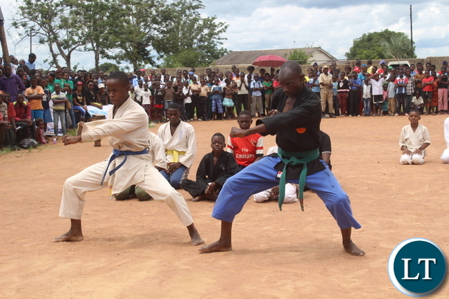 """Karaters  entertain the crowd  during the Youth Day Celebrations held yesterday in Monze under the theme, """"""""Youth: Champions of Dialogue, Peace, Unity and Economic Emancipation."""""""