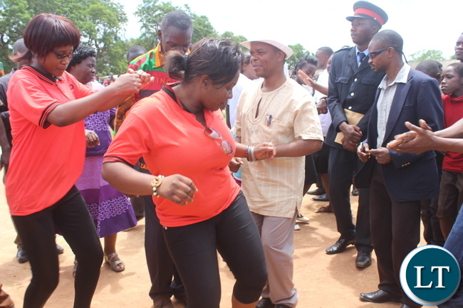 Scores of Monze Youths dance with Deputy Minister of Education Mr. Sydney Mushanga ( in white hat)during the Youth Day Celebrations