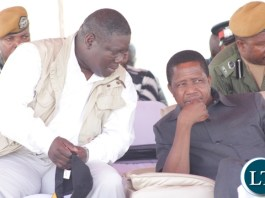 President Edgar Lungu (r) listens from Works and Supply Minister Yamfwa Mukanga (l) during the official commissioning of the Sioma Bridge built at a cost of K108.2million in Sioma District of Western Province