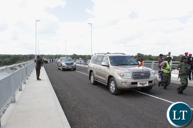 Presidential Motor Cade crossing Sioma Bridge after the official commissioning of the bridge built at a cost of K108.2million in Sioma District of Western Province