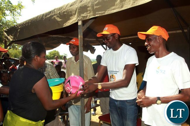 CSO-SUN officials handing over promotional items during the awareness raising event in Siavonga