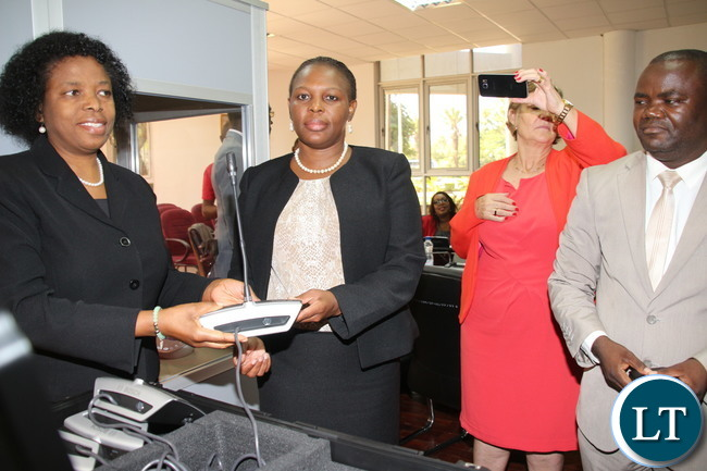 "Ministry of Finance Budget and Economic Affairs Permanent Secretary Mrs Pamela Kabemba and National Assembly of Affairs Mrs Cecilia Mbewe receiving the ""Communication Kit"" that was used during the Inter parliament Union Assembly in Lusaka; the kit was handed over to the National assembly of Zambia"
