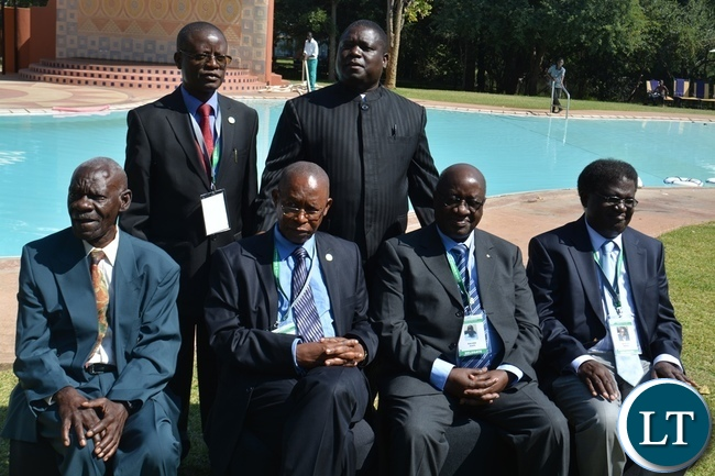 Works and Supply Minister Yamfwa Mukanga (right) and EIZ president Bernanent Chiwala (left) pose for a picture with honoured eminent engineers at AVANI Victoria Falls Hote
