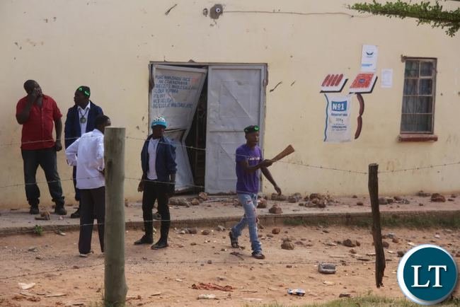 PF Cadres trying to stop the looting of Rwandese Refugees owned shops