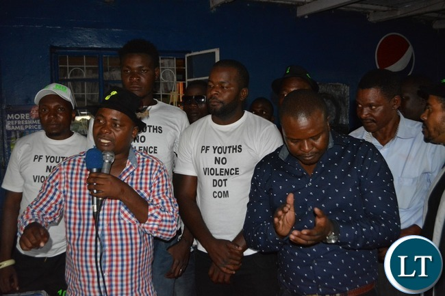 PF Southern Province mobilisation chairman Brave Mwetwa (left) speaks while Livingstone PF district Youth Chairman Obby Mwemba and PF Youths No Violence Dot Com Ambassador Maxwell Chongo look on during the launch of the District Mobilisation Campaign in Livingstone