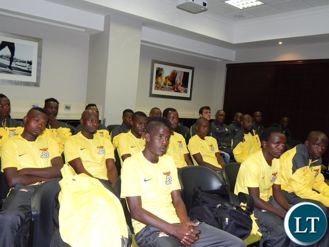 The Zambian players listen to Charge D' Affaires at the the Zambian High Commission, Philomena Kachesa before their game against Tunisia at Ellis Park Arena, Johannesburg, South Africa