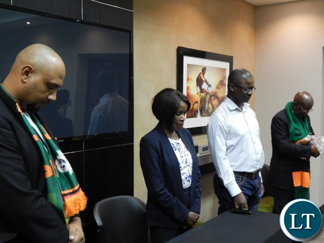 Delegation leader Lee Kawanu,Charge D' Affaires at the the Zambian High Commission, Philomena Kachesa, First Secretary at the Zambian High Commission Josephat Sakala and Deputy delegation leader Julio Chiluba in prayer before their game against Tunisia at Ellis Park Arena, Johannesburg, South Africa