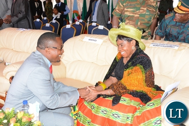 Defence Minister Richwell Siamunene chats with Chieftness Nkomesha Mukamambo II at the official ground breaking ceremony of ZAF twin Palm Public Private Partnership Project on Support Social Amenities and Commercial Facilities whilst Lt Muwindwa Liusha looks