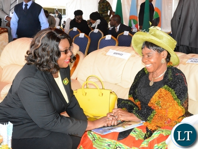Energy Minister Dora Siliya chats with Chieftness Nkomesha Mukamambo II at the official ground breaking ceremony of ZAF twin Palm Public Private Partnership Project on Support Social Amenities and Commercial Facilities whilst Lt Muwindwa Liusha looks on