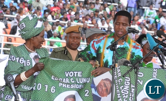 President Lungu and Vice President Inonge Wina looking at the PF new material at the lunch of PF Campaign in the Heroes Stadium