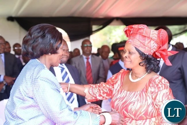 First Lady Esther Lungu(r) being welcomed by Vice President Inonge Wina(l) during the celebration of Africa Freedom day at State House